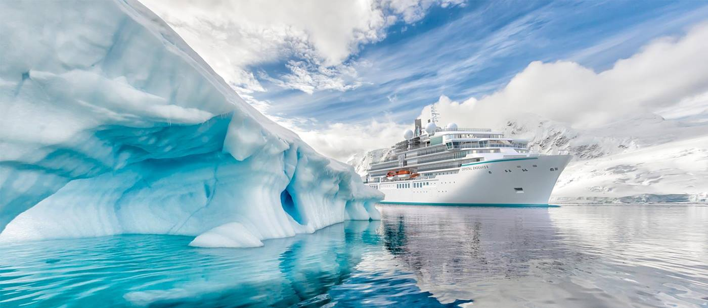 Luxury Cruise Ship Crystal Endeavor sailing past an iceberg