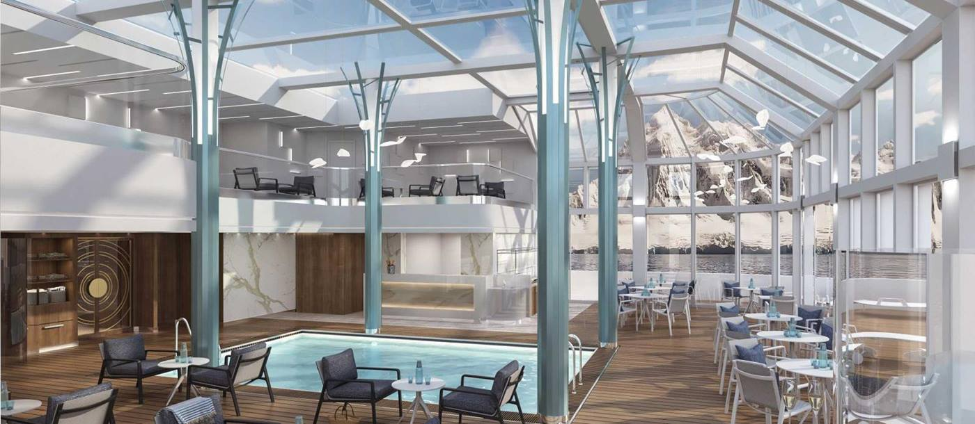 Panoramic lounge with two swimming pools and bar on Crystal Endeavor in the Antarctic