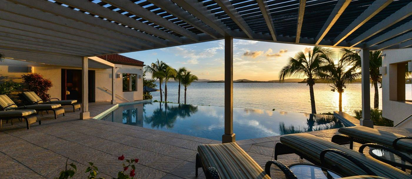 The swimming pool during sunset at Dondiford Cottage, Antigua