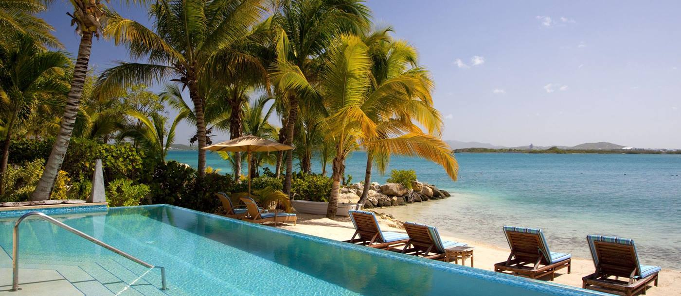 Swimming pool and beach at Sandy Cove, Antigua