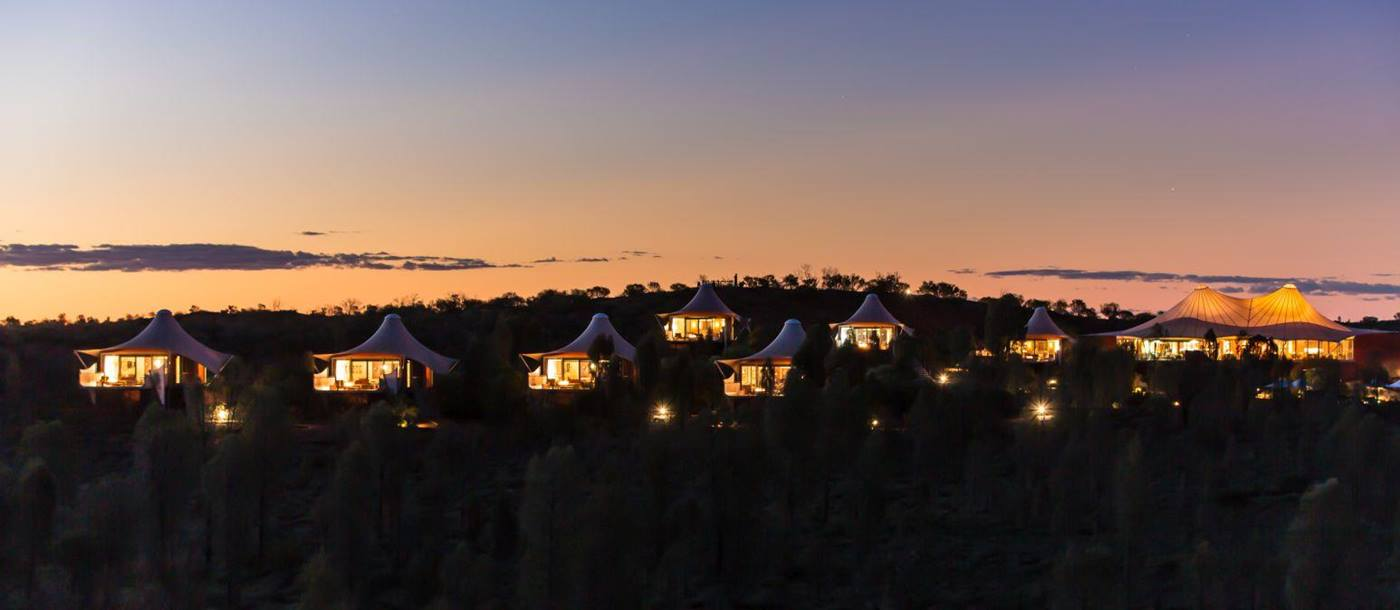 Luxury tents in the outback at sunset at Longitude 131 camp Ayers Rock Australia
