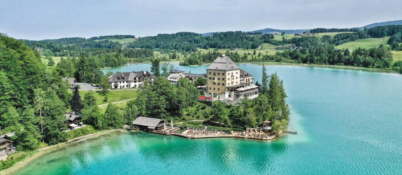 Aerial view of luxury hotel Schluss Fuschl in Austria and the lake