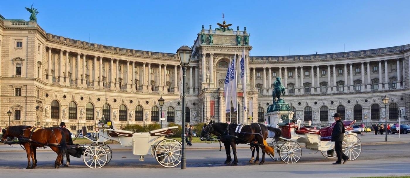 Hofburg palace with horse and carriage in Vienna Austria