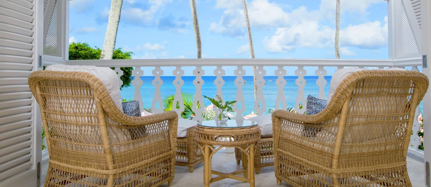 Two chairs overlooking the sea on the terrace of ocean front suite