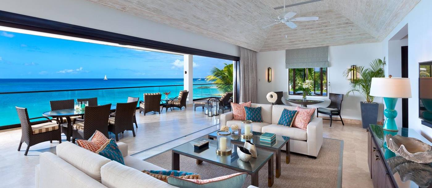 Living room and terrace ofo a suite at Sandpiper, Barbados