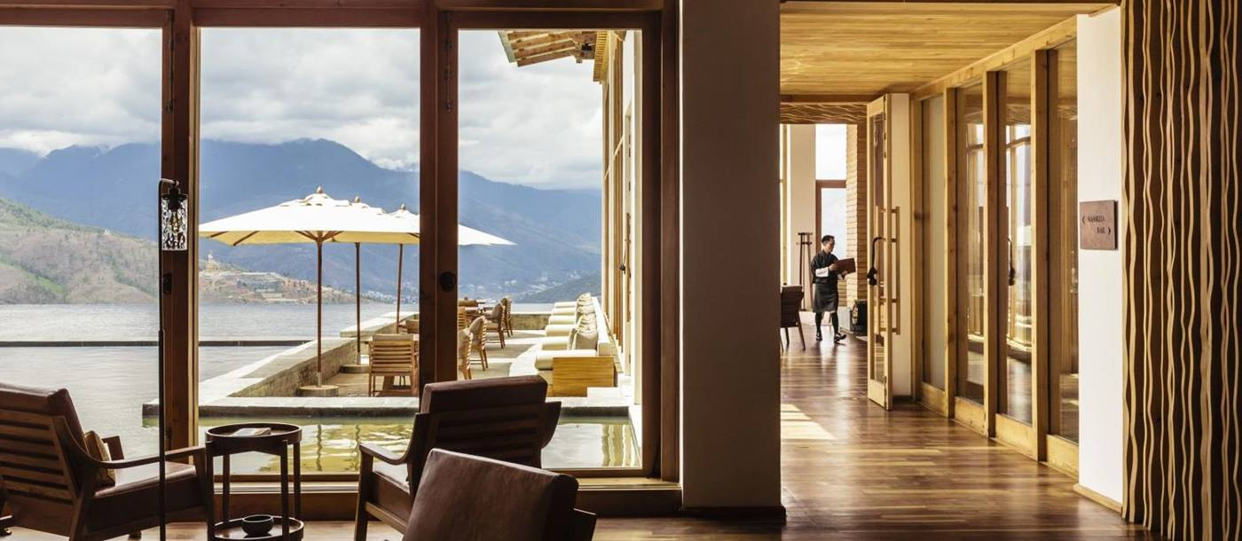Main sunlit lobby with seating and mountain view at Six Senses Thimpu