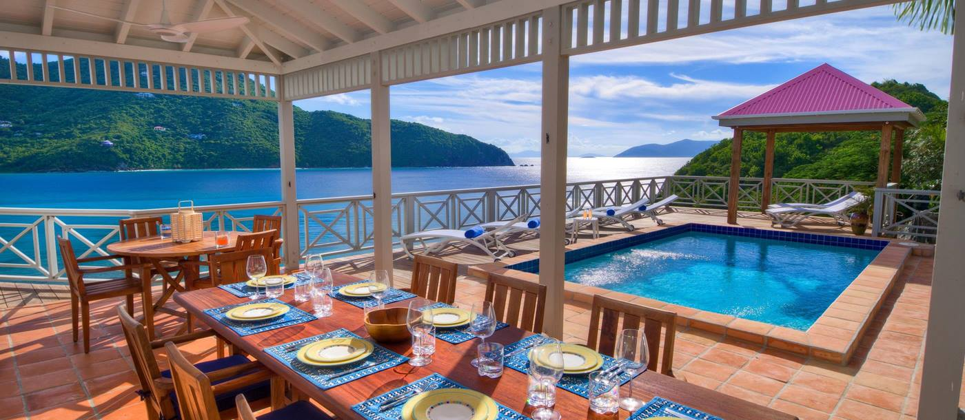 Outdoor dining and siwmming pool of Outer Banks, British Virgin Islands