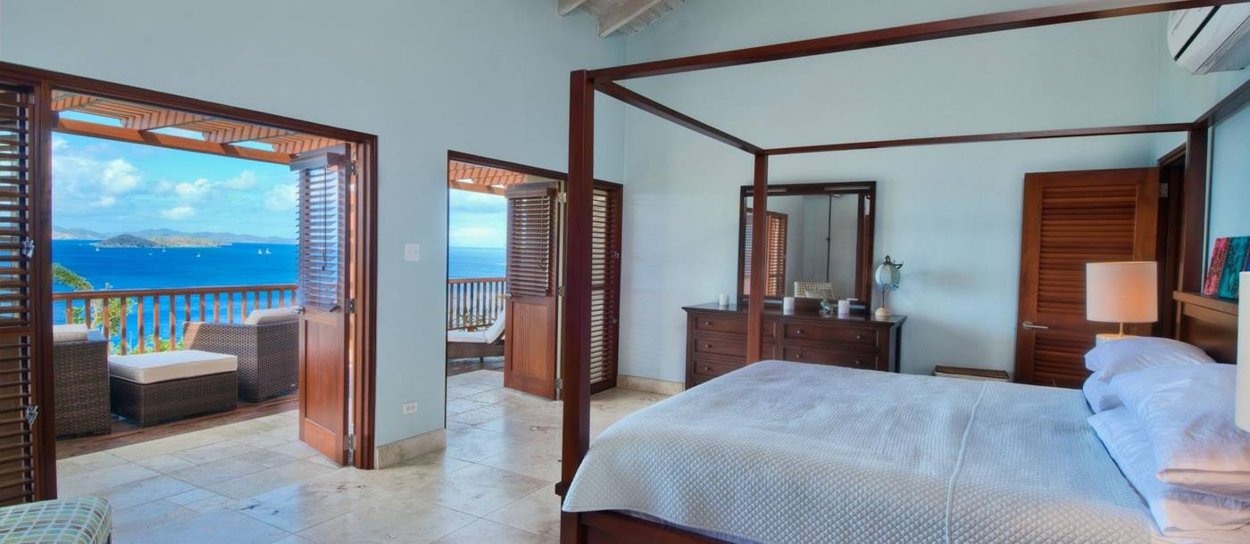 double bedroom with terrace access at Turtle Bay House, British Virgin Islands
