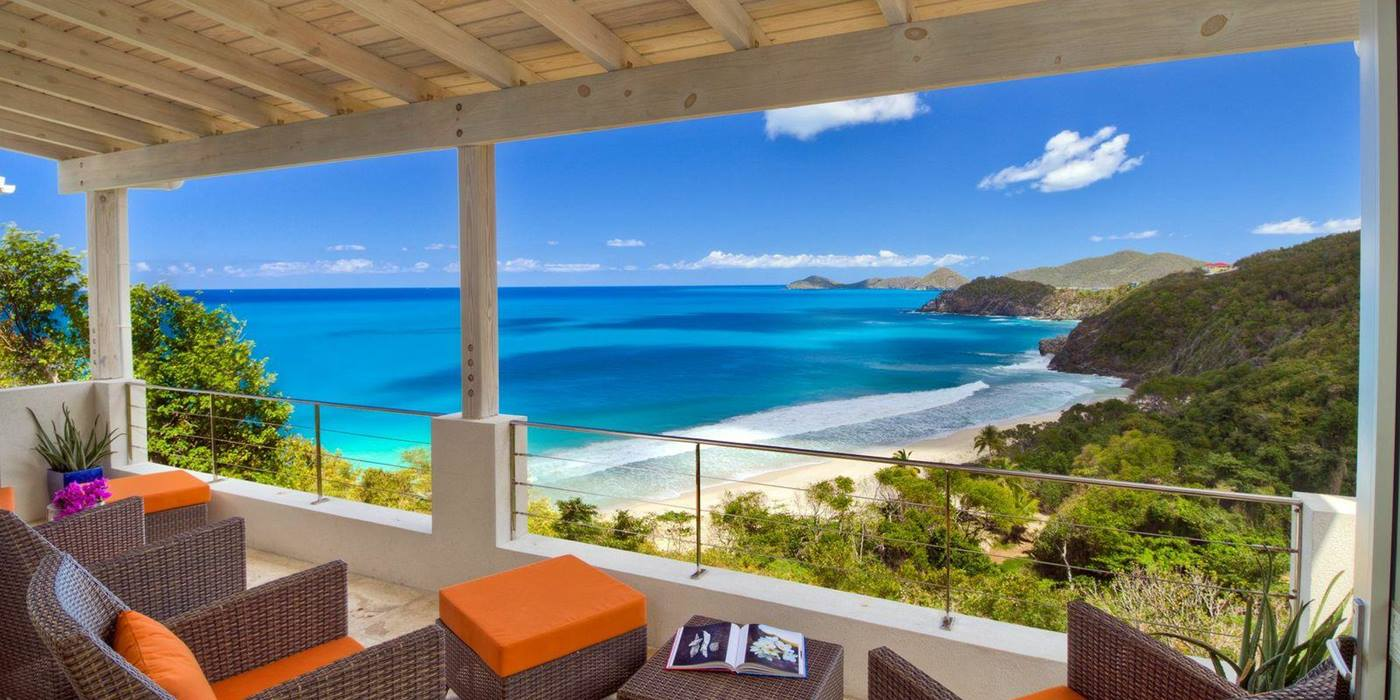 outdoor sitting area with view over beach at swimming pool of Villa Soleile, British Virgin Islands