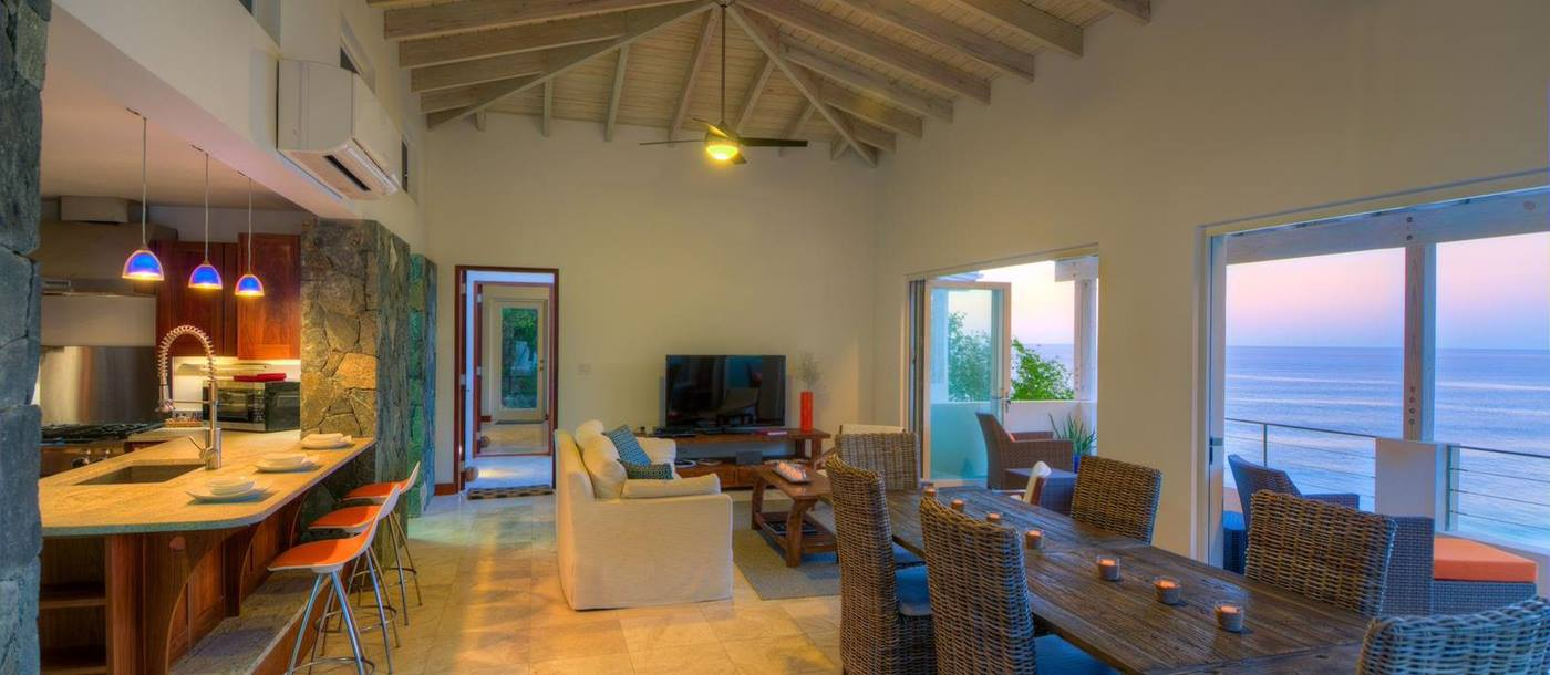living room and dining table of swimming pool of Villa Soleile, British Virgin Islands