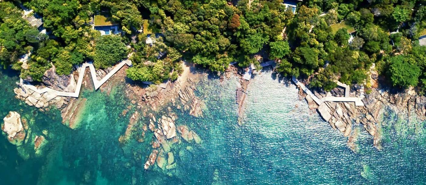 An aerial perspective of the beach at Six Senses Krabey