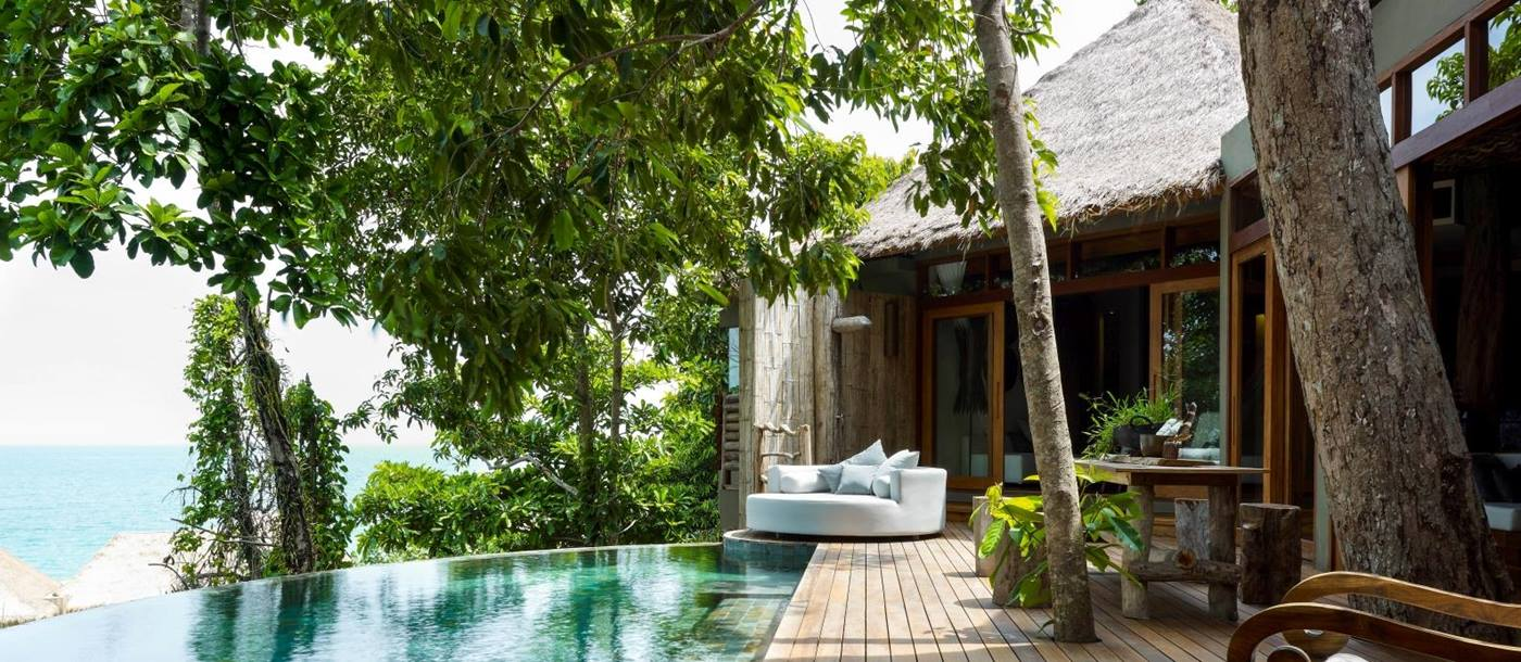 Decking and infinity pool in jungle villa at Song Saa