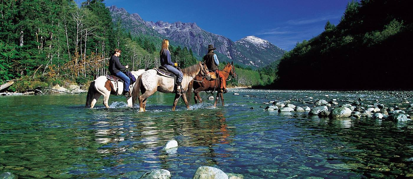 horse riding in river near Clayoquot Wilderness Resort, canada