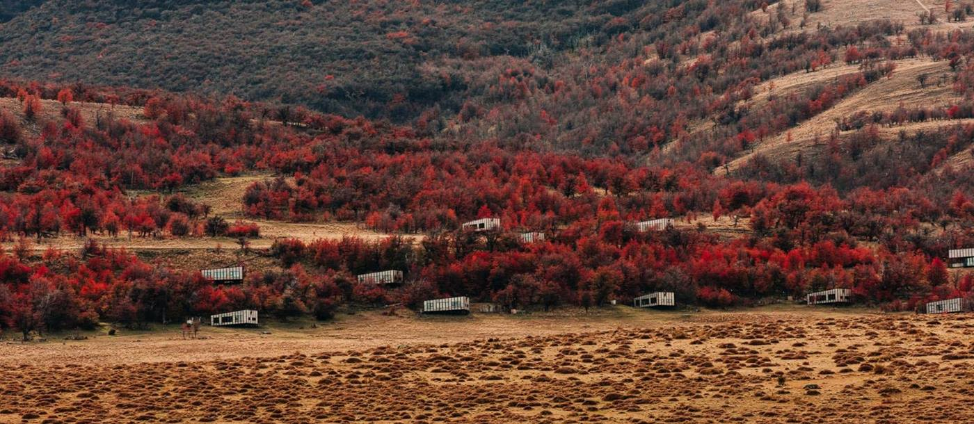 Aerial view of Awasi Patagonia amidst the autumn-coloured trees
