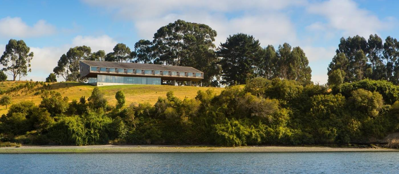 Exterior view of Tierra Chiloe on a hill overlooking a lake