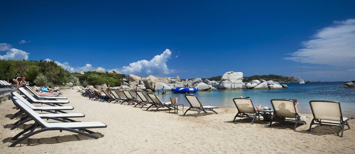 sunbeds on the beach at Hotel  & Spa des Pecheurs, Corsica, France