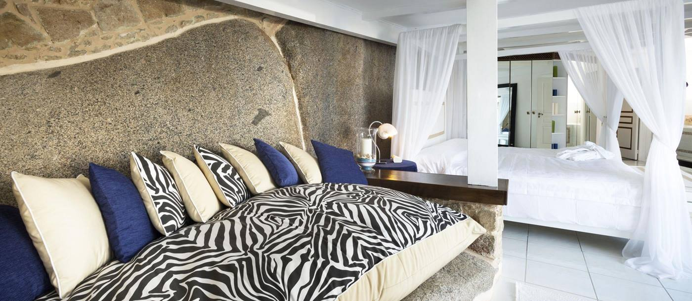 striped furnishings in a bedroom at Hotel  & Spa des Pecheurs, Corsica, France