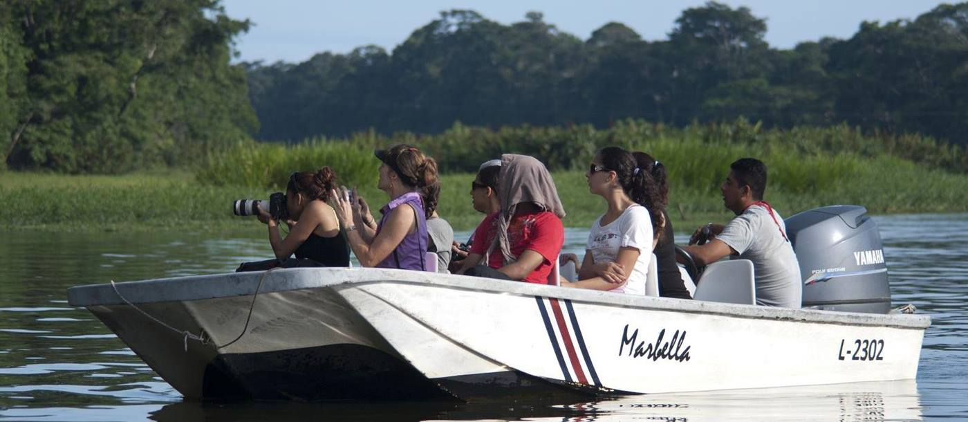 a boat with tourists on the tortuguero