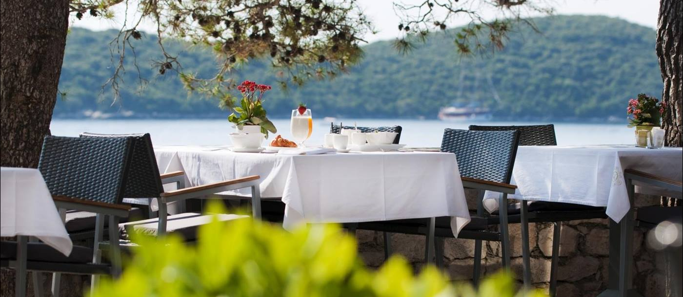 Outdoor dining overlooking the water at Lesic Demitri Palace in Croatia