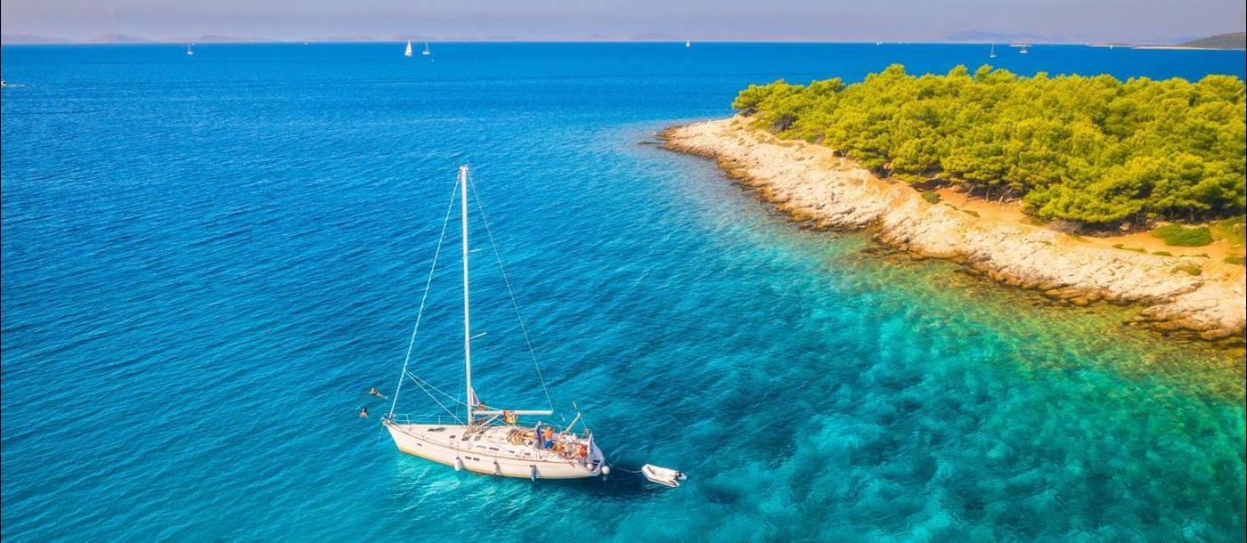 Aerial view of a gulet sailing in turquoise waters in Croatia