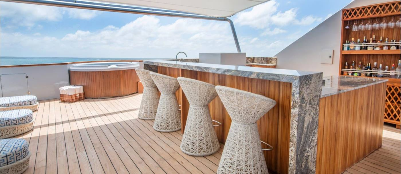 Sundeck and bar on board Theory in the Galapagos