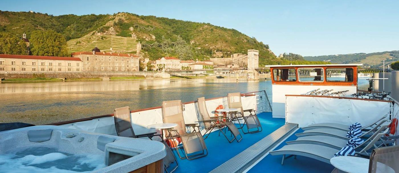 Jacuzzi and sun deck on board the Belmond Napoleon river barge in France