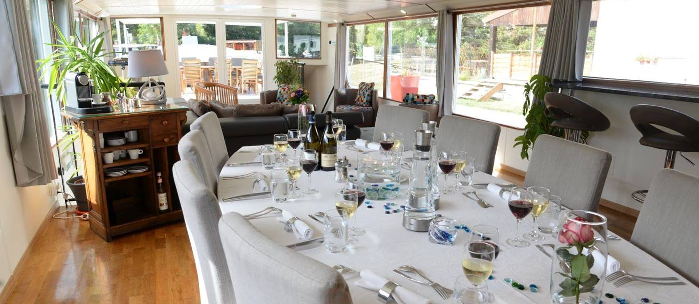 Dining room on board the Finesse river barge in France