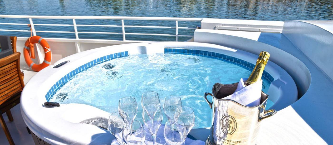 Champagne in the hot tub on board the Finesse river barge in France