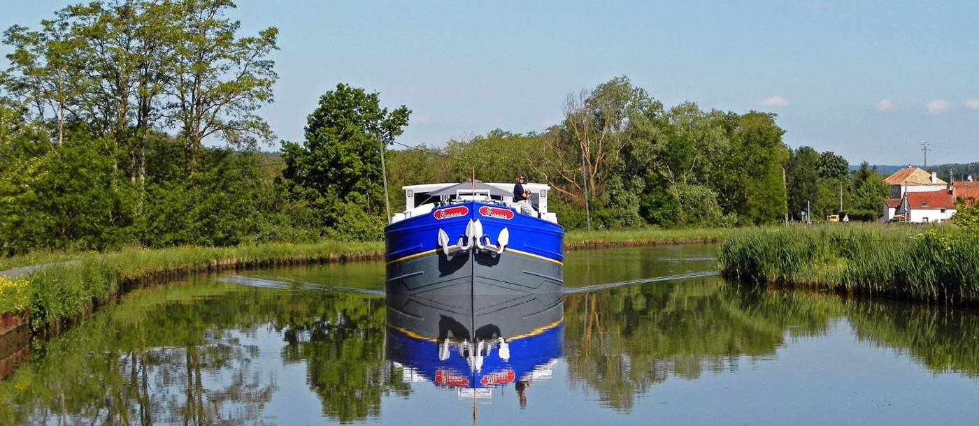 The Finesse river barge sailing through the French countryside