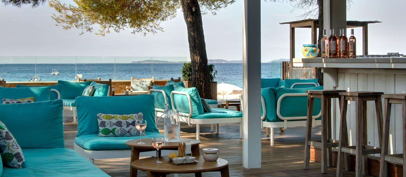 Relaxed bar area at Hotel La Pinede Plage in France
