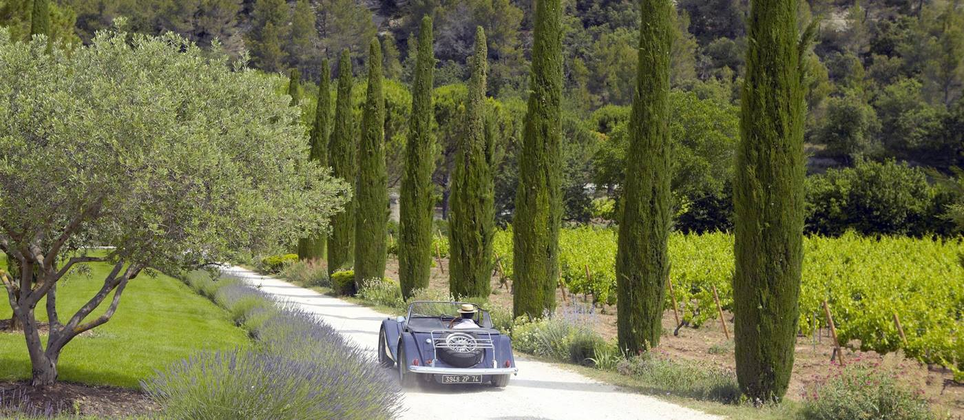 Drive way to La Bastide de Marie, France with driving car