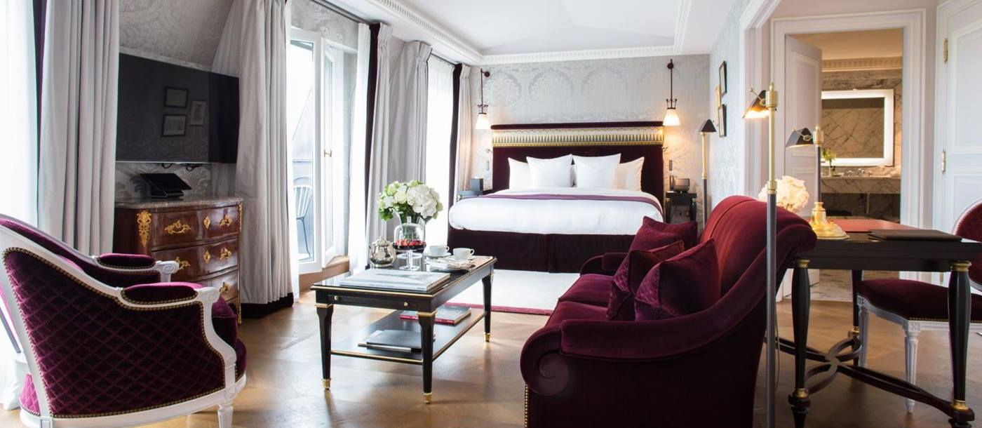 Bedroom suite and living area at La Reserve Hotel in Paris