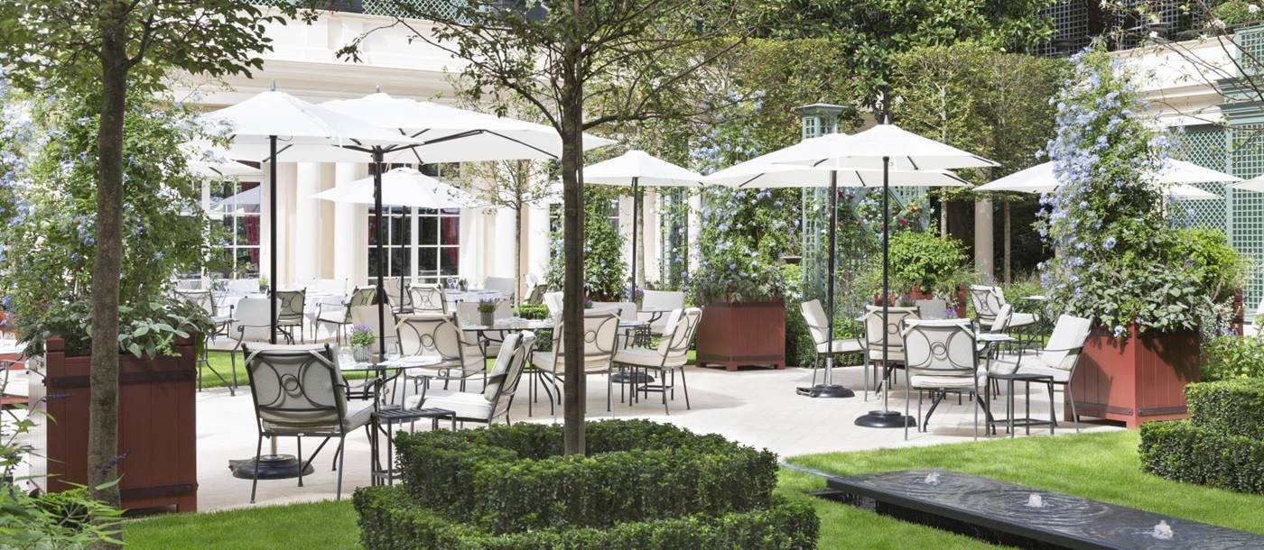 Terrace dining in the gardens of luxury hotel Le Bristol in Paris, France