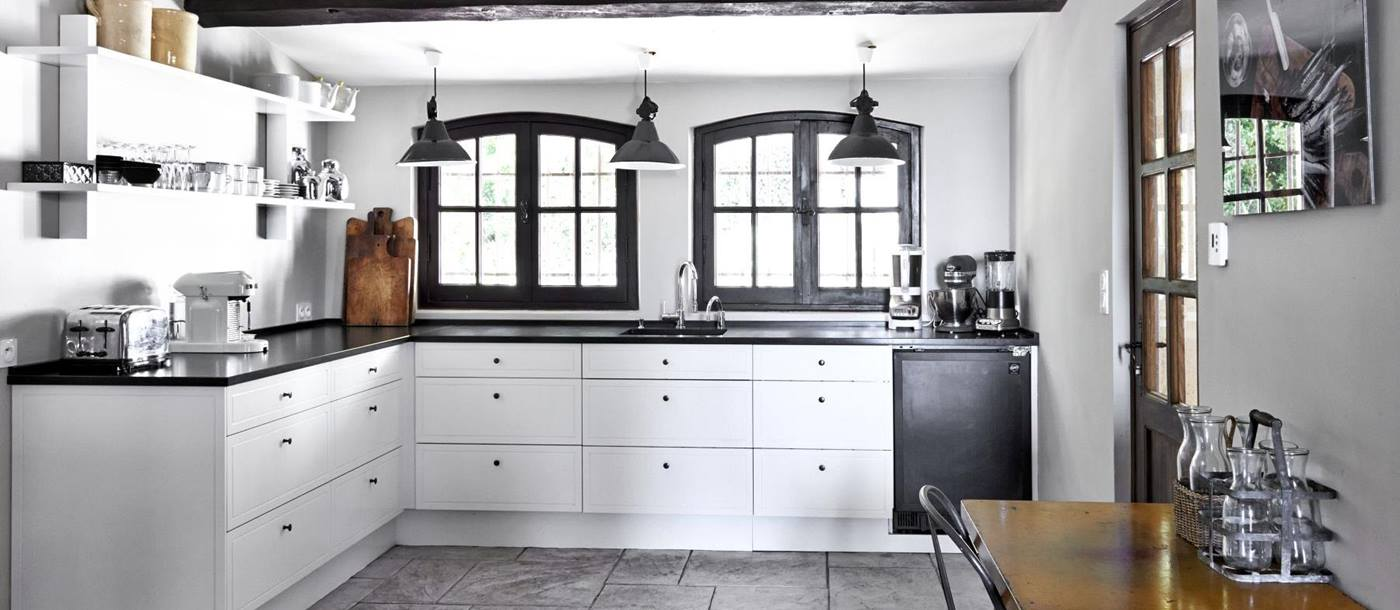 Kitchen with white units at Villa Les Hauts de Vence in the Cote dAzur
