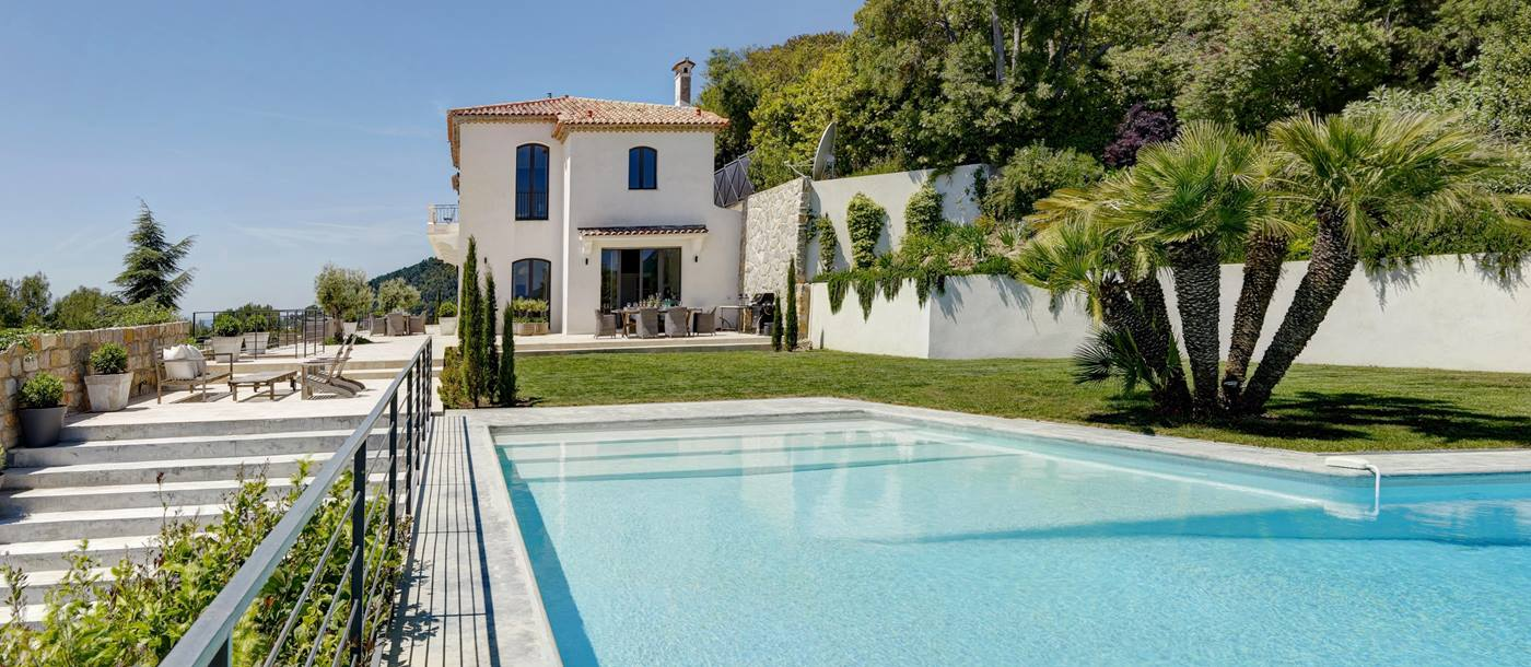 Pool with view of villa and terrace at Villa des Cygnes on the Cote d'Azur, France