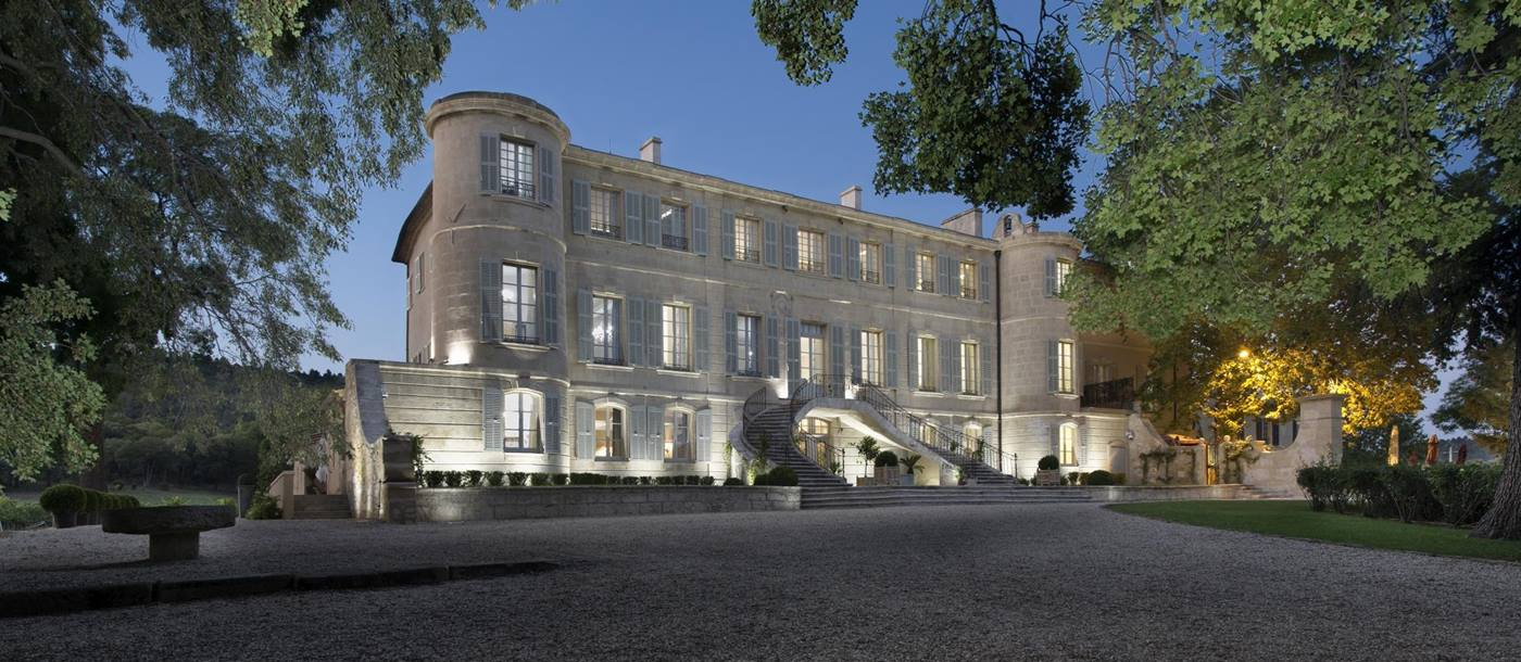 Exteriors of Chateau d'Estoublon at night in Provence