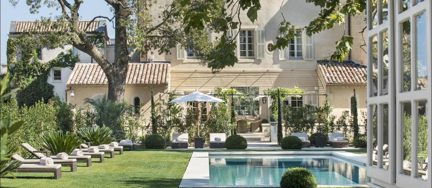 Pool and lawn with sun loungers at the Chateau d'Estoublon in Provence, France