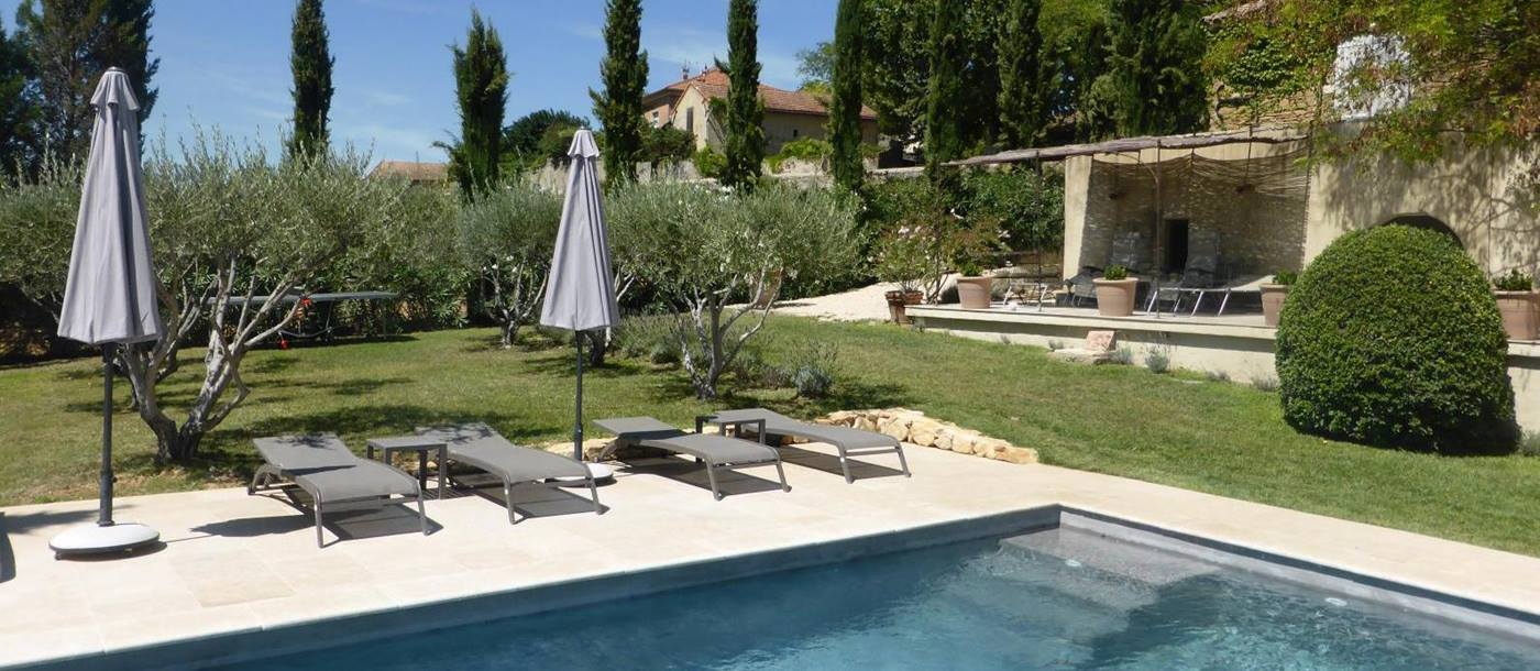 Sunbeds at the swimming pool of Villa Romaine, Provence