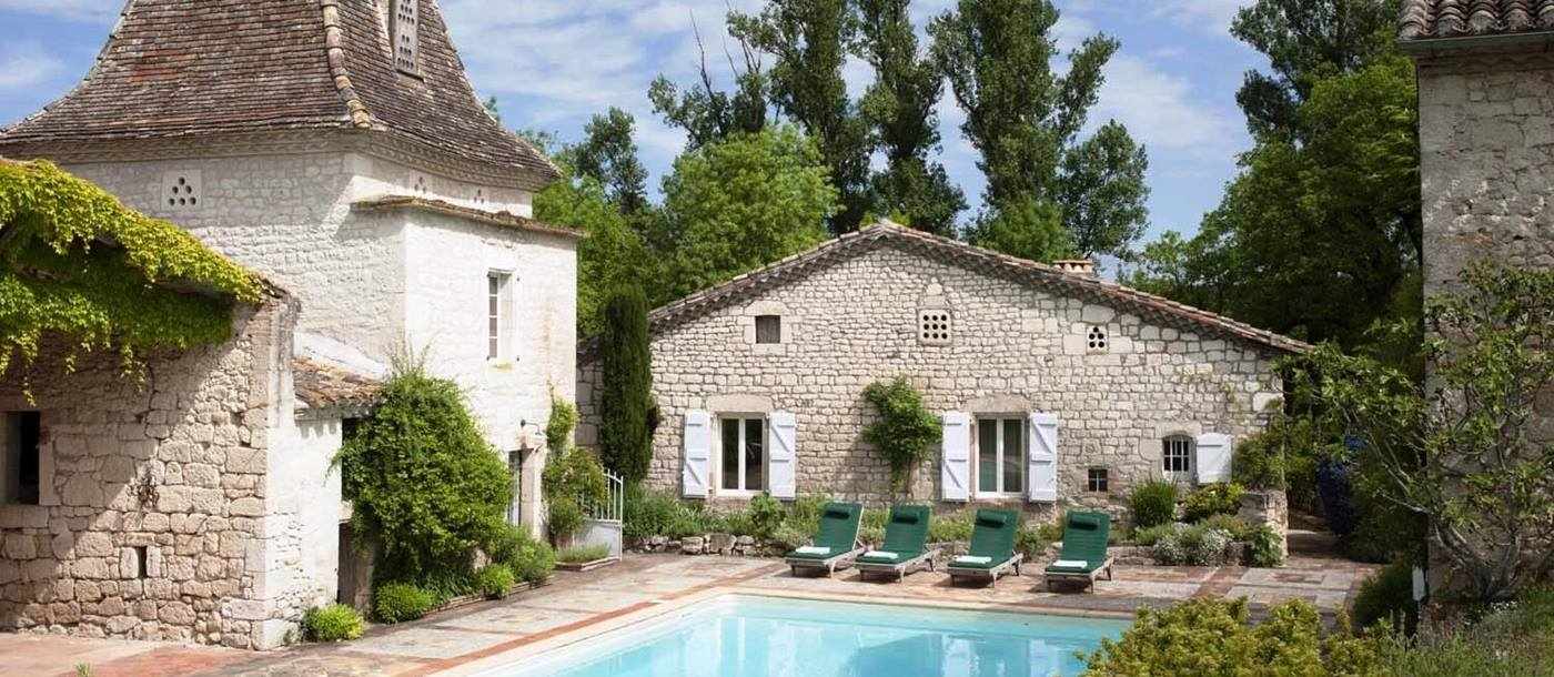 Facade and swimming pool of Hameau d'Albi, South West France