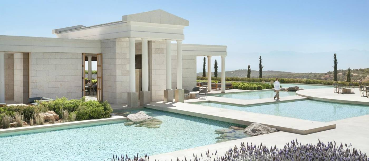 Ancient Greek style white building with pillars - the arrival pavilion at Amanzoe