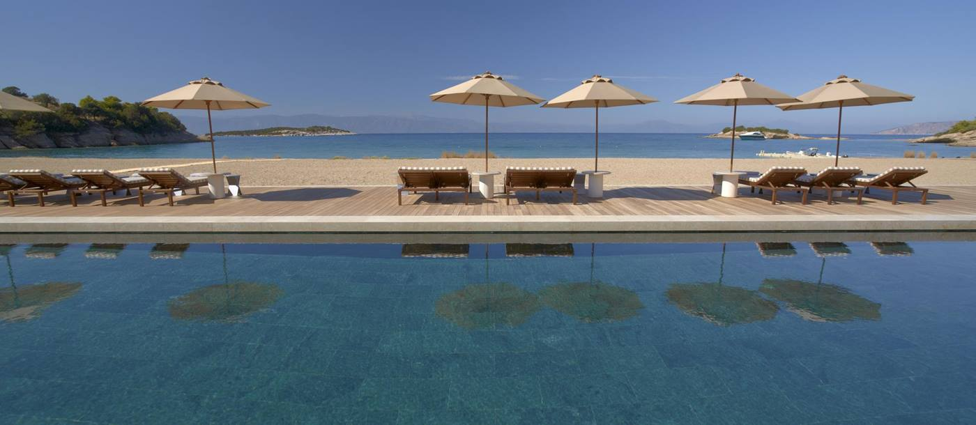 Swimming pool at the beach club of Amanzoe, Greece
