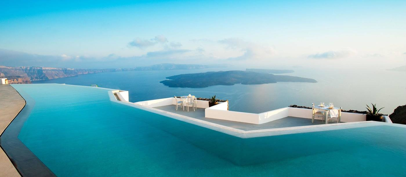 The infinity pool with sea view from Grace Hotel Santorini in Mykonos, Greece