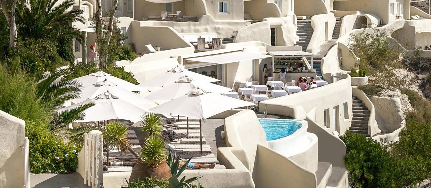View over the restaurant and pool at Mystique in Santorini Greece