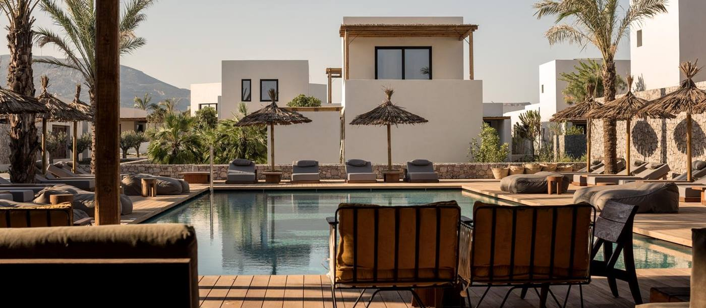Pool with plenty of seating, loungers and parasols at luxury hotel OKU Kos in Greece