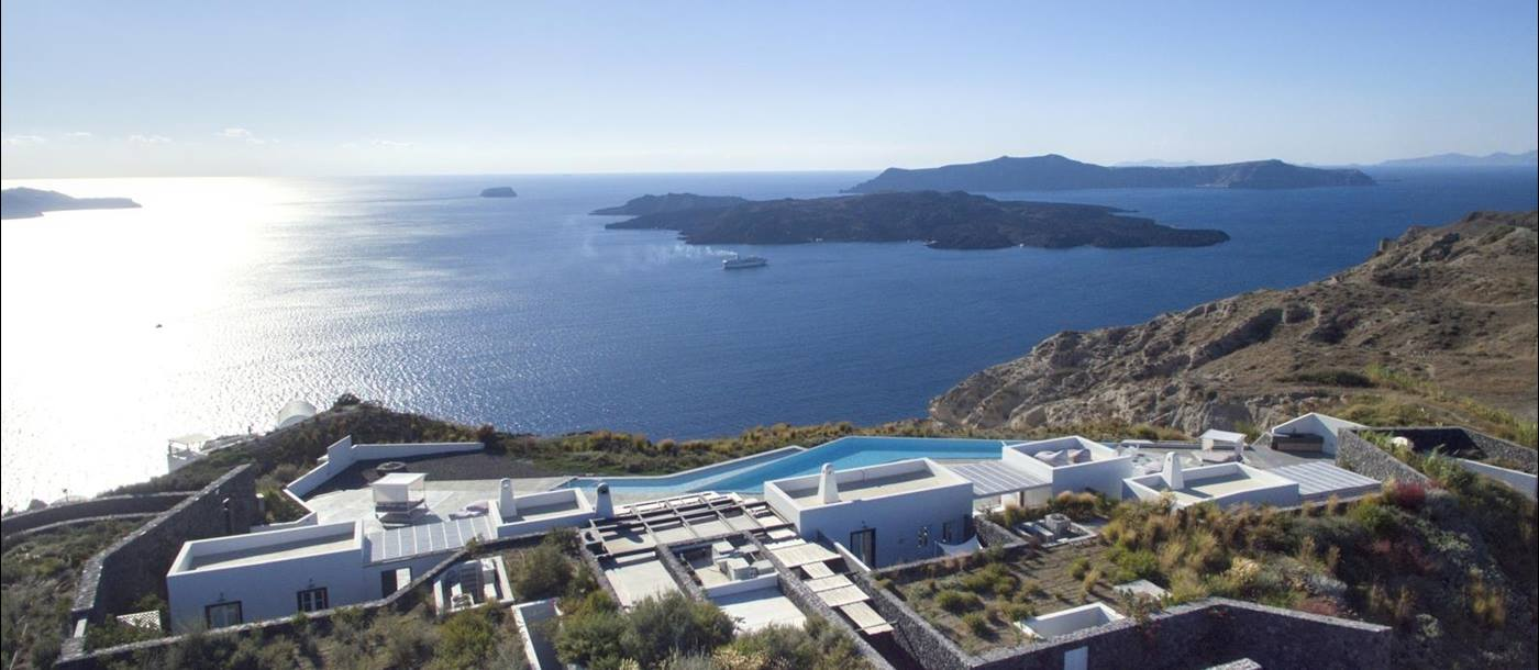 Aerial view of villa, its surroundings, and the sea at Erosantorini on Santorini, Greece
