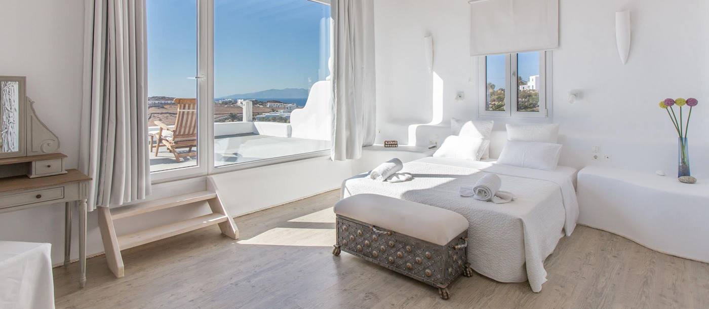 Interiors of an ensuite double bedroom in Kalafati Estate, Greece