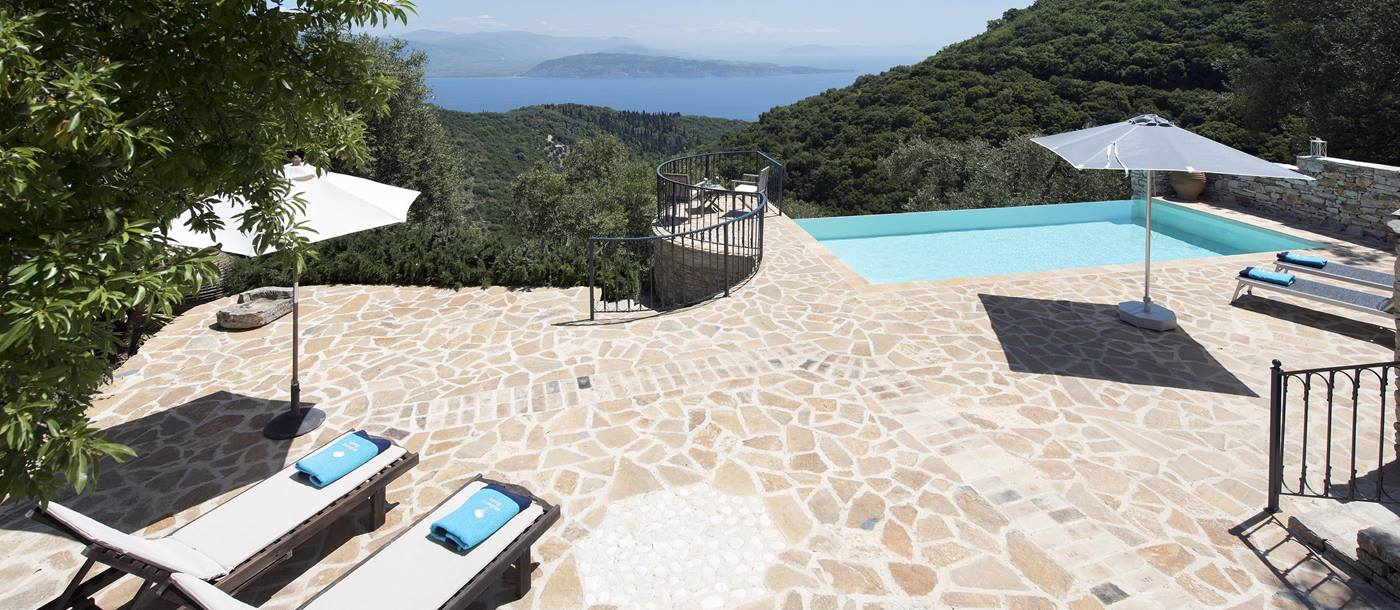 The terrace with swimming pool and sun loungers with sea view of Morus, Greece