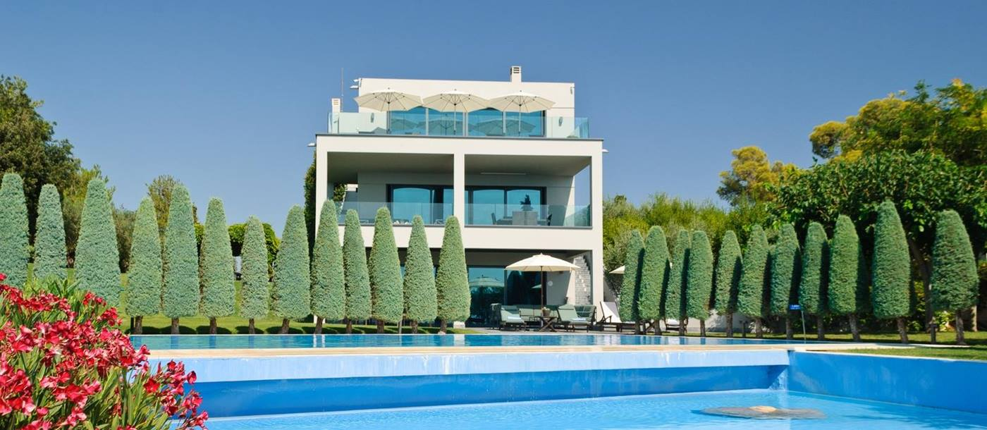 exterior and swimming pool of Seafront Villa, Greece