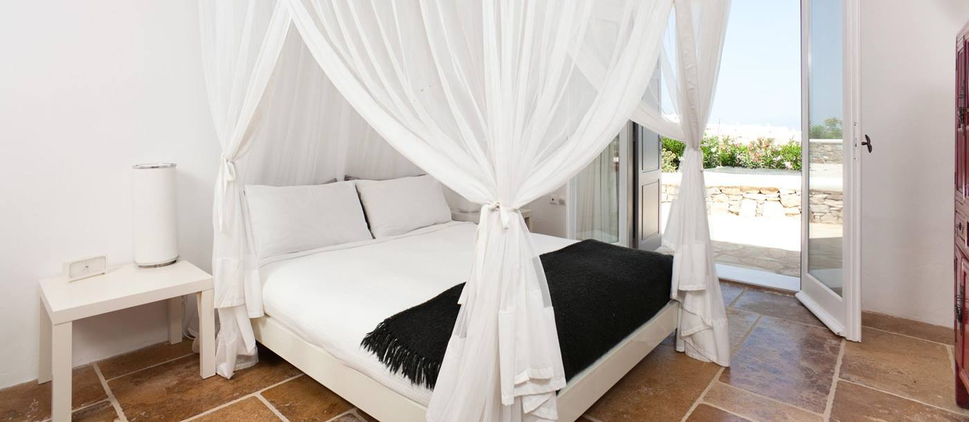 Double bedroom with mosquito net in Villa Orpheus, Greece