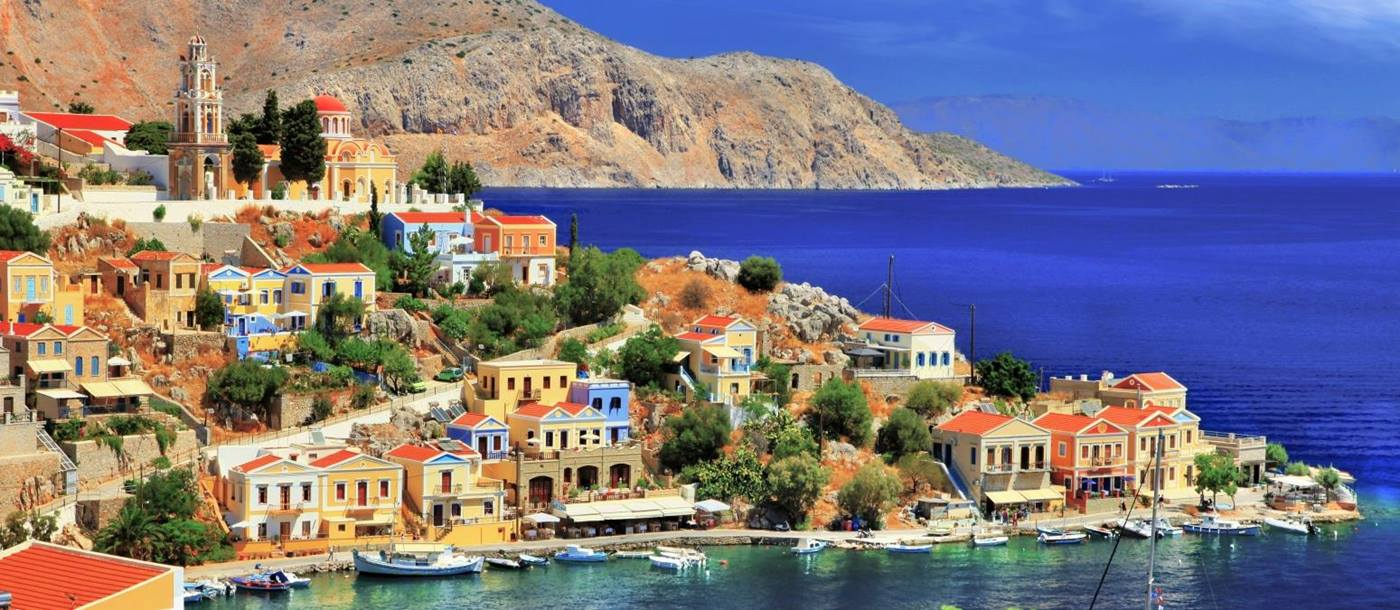 View of Symi Island with a cove and orange and yellow houses